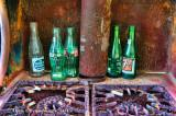 Pop Bottles and Rusted Gas Stove