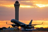 2010 - American Airlines B757 takeoff at Miami International Airport aviation sunset stock photo