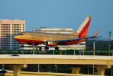 2012 - Southwest Airlines B737-7H4 N792SW in the Retro Gold scheme on approach to 1L at TPA airline aviation stock photo