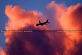 2012 - American Airlines B757-223 N183AN flying past colorful clouds over Miami lakes after sunset aviation stock photo