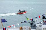 The newly commissioned USCGC BERNARD C. WEBBER (WPC 1101) and a 25-Foot Defender Class Boat CG-25505 patrolling nearby