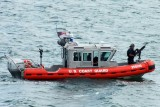 Coast Guard 25-Foot Defender Class Boat CG-25505 patrolling near the newly commissioned USCGC BERNARD C. WEBBER