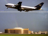 1975 - British Airways B747-100 taking off with the National Airlines Maintenance Base in the background