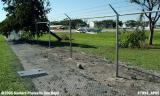 Negro Airmen International Inc.'s C-172N N1993E and fenceline damaged by Hurricane Wilma stock photo #7093