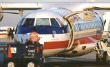 1999 - Will Work for Food cockpit sunscreen on American Eagle ATR-42