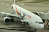 Malaysian Airlines A-330 in the new livery at its gate in PVG