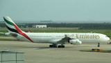 Emirates A-340 leaving its gate, PVG, Sept  2011