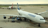 Finair A-340 at its gate in PVG