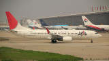 JAL B-737-800 taxi at PVG, with China Eastern fleet in the background