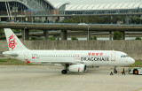 Dragon Air A-320 being pushed back from its gate, PVG, Sep 2011