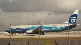 Alaska B-737-700 in special color scheme taking off along MIA Runway 27