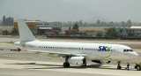 An A-320  belong to Sky Airlines in Chile in a hybrid livery