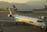 Pluna CRJ-900 being lit by the setting sun in SCL