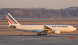 Air France A-330 dashing down JFK Runway 22R basked in the golden ray of the setting sun.