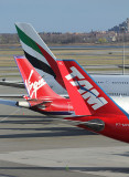 Tails from three continents meet in JFK