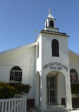 I had reserved a motorcycle from Captain Van's in West End (here's a church there) to explore the 49 sq. mile island.