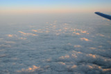 Sunrise hitting the tops of the clouds
