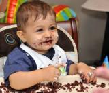 Birthday Boy proud that he destoyed his cake.