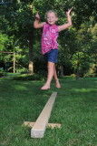 Macey leaping on the balance beam