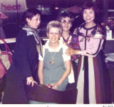 Julie Fletcher posing with some Japanise fans.