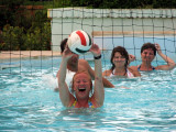 Judy plays water volleyball