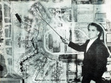 Early 1970's - Aviation Director Dick Judy in front of an aerial future growth photo of Miami International Airport