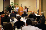 Sonja R. Judy speaking to the guests at the Richard H. Dick Judy Celebration of Life luncheon at MIA