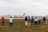 2012 MIA Airfield Tour - bus #2 tour group with Avianca A320 taking off on runway 27 in the background