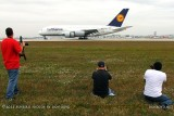 2012 MIA Airfield Tour - some photogs from bus #2 tour group with the Lufthansa A380 landing on runway 27 in the background