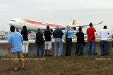 2012 MIA Airfield Tour - closeup of tour group photographing Iberia A-340 landing on runway 30