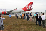 2012 MIA Airfield Tour - tour group photographing Virgin Atlantic B747-4Q8 G-VHOT landing on runway 30