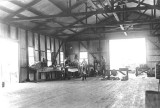 1917 - Mechanics working on a Curtiss Jenny OX5 engine at Curtiss Air School hangar