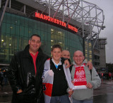 John & Kieran with cheery Poland supporters at Old Trafford