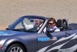 Dan Gurney, 79, being driven by son Alex around the Mazda Raceway Laguna Seca in a Mazda MX-5 Miata (2813)
