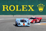 1969 Porsche 917K (1st place) and 1969 Lola T70 Mk 3B (2nd) in Group 5A race of 2010 Rolex Monterey Motorsports Reunion (3368)