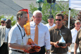 Best of Show car owner Jim Patterson, left, receives the Governor's Cup and The Elegance at Hershey Kiss Trophy. (4822)