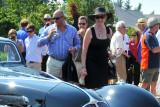 Pebble Beach Concours Chairman Sandra Button, in black, and husband Martin Button, in stripes, were among the judges. (4830)