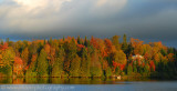 Late afternoon sunlight on autumn colours in the Laurentian Mountains