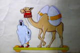 A camel brings gifts for Easter .......!! There 's something that contrasts.......
