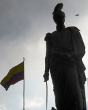Statue of Bolivar and Flag of Colombia.jpg
