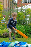 Cricketer Tom plays a cover drive