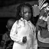 Close to her mum who`s performing a dance from Sierra Leone on stage