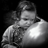Pensive little girl with balloon