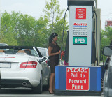 A Mercedes driver looks for inexpensive gas
