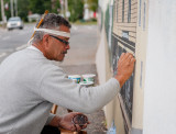 A local muralist at work