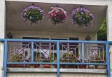 Balcony with flower baskets