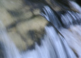 soft rock under rushing water
