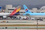 Seoul mates!! Asiana Boeing 747 and Korean Air Boeing 777.  Both caryring the flag of South Korea