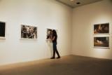 Anna walks around the gallery space
