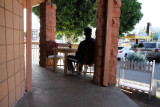 man sitting outside the Thai restaurant where we ate